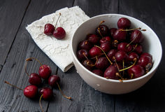 Some fresh ripe red cherries. On black table Royalty Free Stock Image