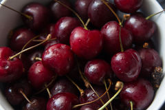 Some fresh ripe red cherries. On black table Royalty Free Stock Images