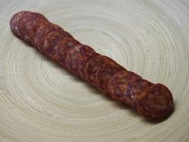 Some fresh sausage. Some fresh, cutted sausage on a plate stock images