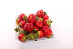 Some of fresh Strawberries for diet. Fresh strawberries fruits on white dish royalty free stock photography