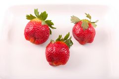 Some of fresh Strawberries. Fresh strawberries fruits on white dish stock image