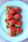 Some fresh strawberries. On a green plate Stock Image