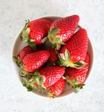 Some fresh strawberries. On marble background stock image