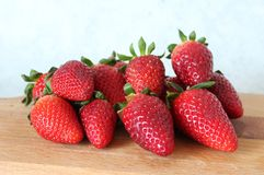 Some fresh strawberries. On marble background royalty free stock images