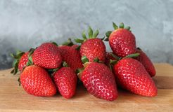 Some fresh strawberries. On marble background Royalty Free Stock Photo
