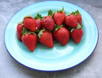 Some fresh strawberries. On a green plate Stock Photography