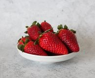 Some fresh strawberries. On marble background royalty free stock photos