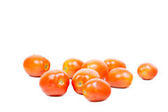 Some fresh tomatoes on white. Some fresh red tomatoes isolated on white Stock Photos