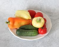 Some fresh vegetables. On a plate stock photo