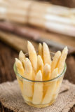 Some fresh white Asparagus (selective focus). On vintage wooden background Royalty Free Stock Image