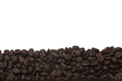 Some freshly roasted coffee beans. Freshly roasted coffee beans and white background Royalty Free Stock Image