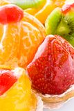 Some fruit cakes. Some the various cakes decorated with berries and fruit close up Royalty Free Stock Images
