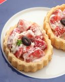 Fruit cakes. Some fruit cakes with strawberries and cream stock image