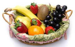 Some fruits in a basket. Isolated on white royalty free stock photography