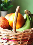 Some fruits in a basket. With nature light stock photography