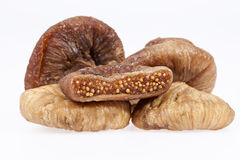 Some fruits of dried fig  on white background Stock Images