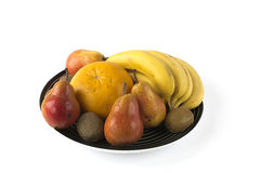 Some fruits on a large dish  on white Royalty Free Stock Images