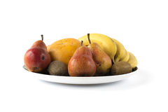 Some fruits on a large dish on white. Some different fruits on a large ceramic dish on white stock photo