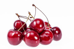 Some fruits of red cherry isolated on white background Stock Photos