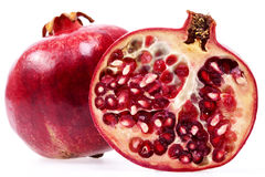 Some fruits of red pomegranate isolated on white background, clo. Se up Royalty Free Stock Photo