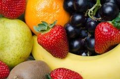 Some fruits. Strawberries, grapes, kiwi, pear and orange Stock Photo