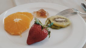 Some fruits in white dish Stock Images