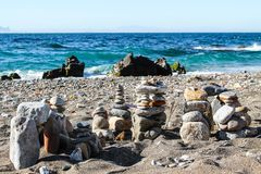Natural sculptures at the beach. Some fun at the beach building small towers with the stones creating a small stone age city royalty free stock photo