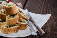 Garlic Bread Appetizer. Some Garlic Bread pieces on wooden background royalty free stock photos