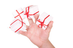 Some gifts in palm. On white background royalty free stock image