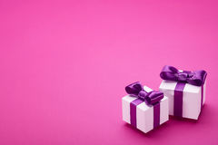 Some gifts on pink background Royalty Free Stock Images