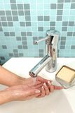 Some girl is washing her hands. Beautiful girl is washing her hands Royalty Free Stock Photography