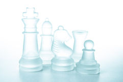Some glass chess pieces. On a white background isolated Stock Photos