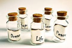 Some glass vial with cork plug with subtitles royalty free stock image