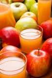 Some glasses of apple juice Stock Image