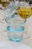 Some glasses. Detail of some glasses and cups arranged on the table royalty free stock photo