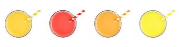 Some glasses with different colors juices on a white background. Top view.  stock photography