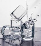Some glasses water spill black white splash motion mirror royalty free stock photography