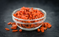 Some Goji Berries dried on a dark slate slab. Portion of Dried Goji Berries on a rustic slate slab selective focus; close-up shot Stock Photography