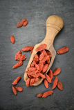 Some Goji Berries dried on a dark slate slab. Portion of Dried Goji Berries on a rustic slate slab selective focus; close-up shot royalty free stock photos