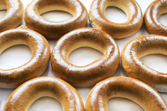 Some golden bagels Stock Images