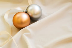 Some golden christmas balls on the white fabric Stock Photo