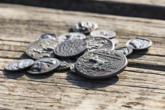 Some Greek metal ancient coins. Stack of various Greek ancient coins above wood background, Athens, Greece royalty free stock images