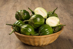Some green african eggplants over a wooden surface Stock Images