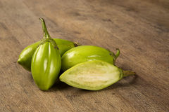 Some green african eggplants over a wooden surface Stock Image