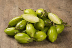 Some green african eggplants over a wooden surface Stock Photography