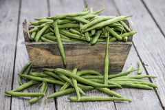 Some Green Beans on wood. En background Royalty Free Stock Photos