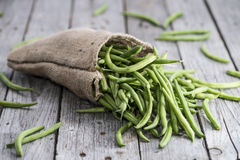 Some Green Beans on wood. En background Stock Image