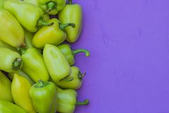 Some green bell peppers on lilac background. Top view royalty free stock images