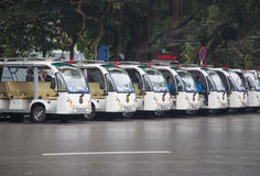 Some green electric vehicles parking in range. Hanoi, Vietnam - Jan 16, 2016: Some green electric vehicles parking in range while waiting for passenger on a ' stock photos