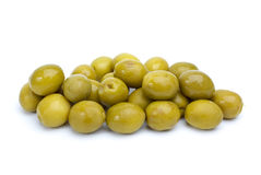 Some green olives with pits. Isolated on the white background stock photography